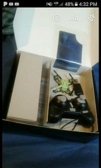 green quadcopter with black remote control in box screenshot