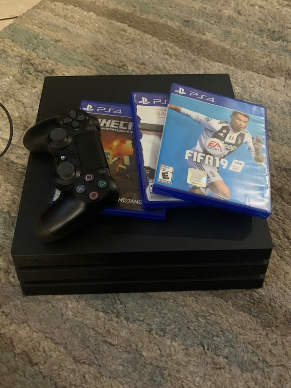 PlayStation 4 pro 1TB with 3 games and controller  2d051098-3da1-48cc-bedb-40d4ca8127a9