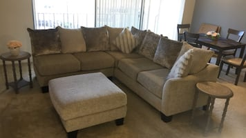 Sectional couch, ottoman and 2 end tables