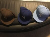 Three black and blue fitted caps
