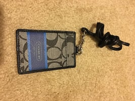 Brown and blue coach keychain with swivel bolt snap hook lock
