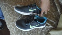 pair of white-and-black Nike running shoes Los Angeles, 90002