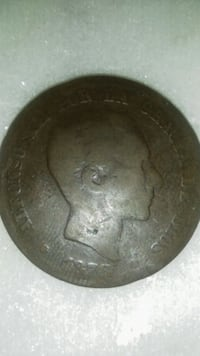 round brown and black ceramic plate Doctor Phillips