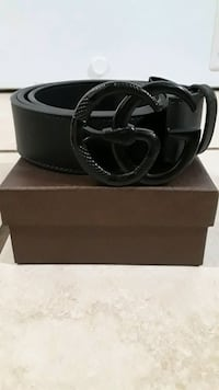 "Gucci Belt New with Dust Bag and Box.Size 36-42""  I have a belt hole p"