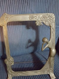 Antique brass frame face reflects Kankakee, 60901