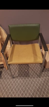 brown wooden framed green padded armchair North Cowichan, V9L 4A3
