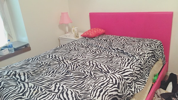 Large bed and side table