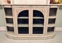 Antique white buffet server with carved wood details and leather top