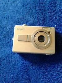 gold-colored Sanyo point-and-shoot camera