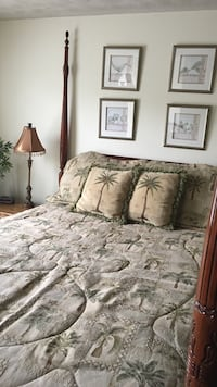 Green and brown palm tree comforter set with three lamps for acceptance and for shams pictures on the wall 33 km