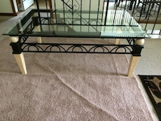 Cream and black rod iron cocktail table