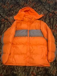 orange and black zip-up bubble jacket