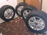 four chrome 5-spoke car wheels with tires District Heights, 20747