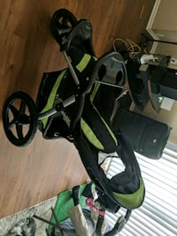 baby's black and green jogging stroller