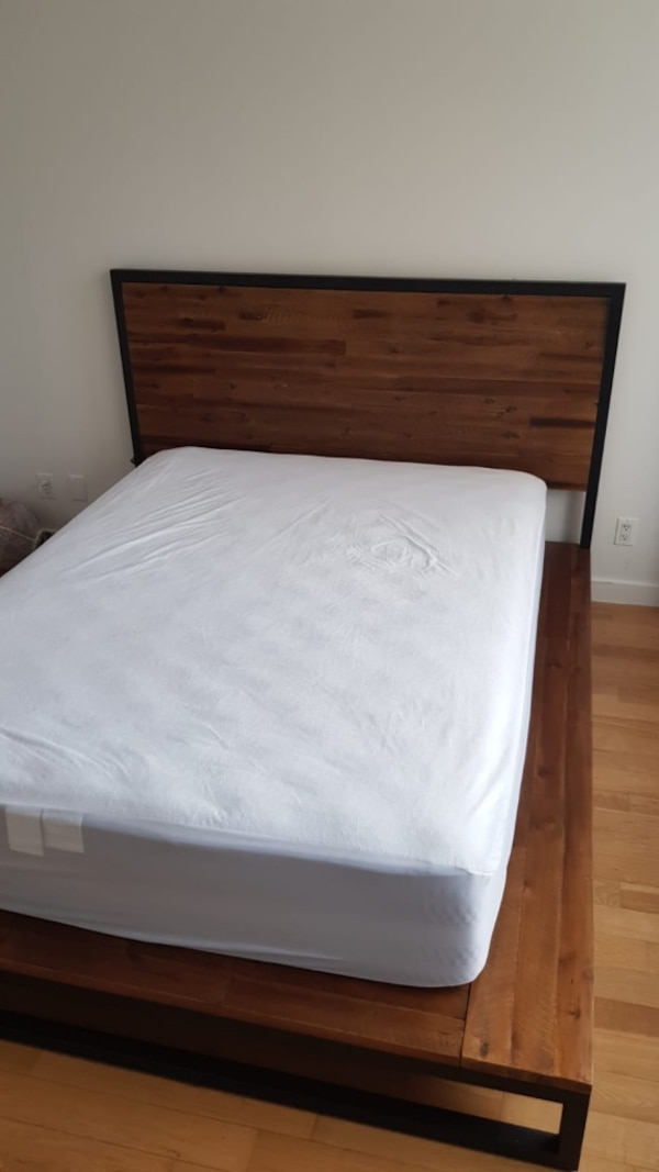 Used white mattress and brown wooden bed frame for sale in New York ...