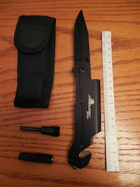 black handled card knife with sheath