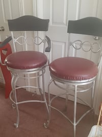 His and her set iron bar stools