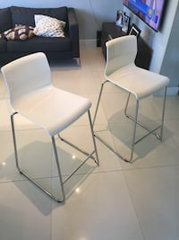 two white leather padded chairs 933 mi