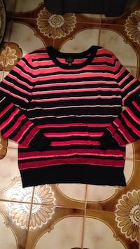 Womans size large sweater but medium could fit too. Stretch. Look for more on my page Islip, 11751