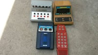 four assorted-color digital electronic devices