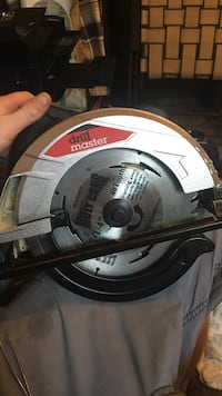 grey and black Drill master circular saw