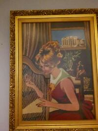 woman in white dress painting with brown wooden frame Montréal, H1Z 2Y1