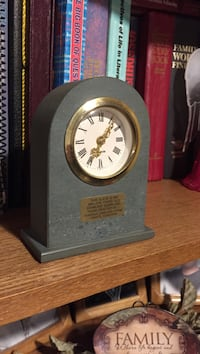 gray and gold analog mantle clock