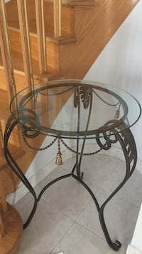 Oval glass top table with black metal base