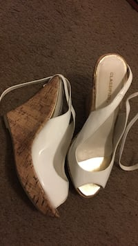 pair of brown-and-white leather open-toe wedge sandals
