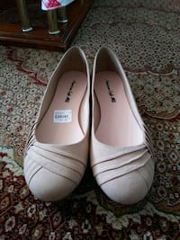 pair of white leather flats Toronto, M4B 2G1