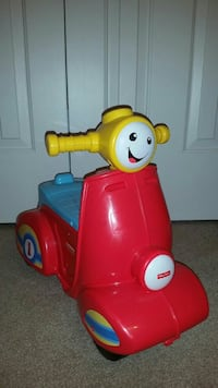 red and yellow Fisher-price ride-on toy