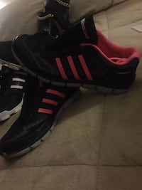 pair of black-and-red Adidas Climacool shoes