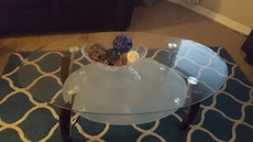 Oval brown wooden base glass table
