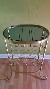 round brown wooden framed glass top table Potomac, 20854