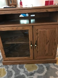 Brown tv stand with glass door  Wayland, 49348