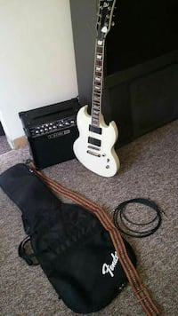 White ESP LTD electric guitar with amplifier and g