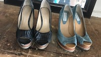 two pair of black and blue open-toe heeled shoes