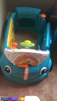 blue and white Fisher-Price ride on car toy