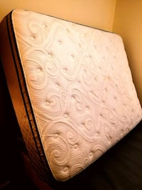 Queen size mattress and box, good as new! Plus bed rails.