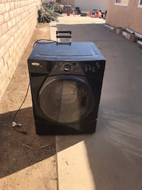 Black front-load clothes washer 2237 mi