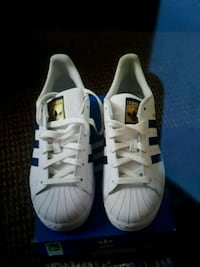 pair of white Adidas Superstar Silver Spring, 20902