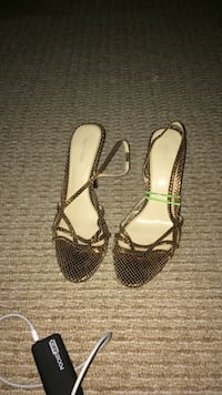 pair of black-and-white leather sandals