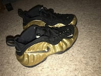 pair of black-and-brown Nike Foamposite Washington, 20024