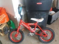 toddler's red and white bicycle Bradford West Gwillimbury, L3Z 0A9
