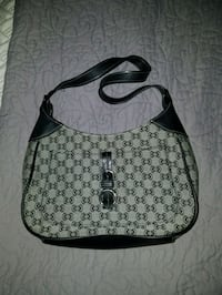 gray and black monogrammed Michael Kors leather hobo bag New Port Richey, 34653