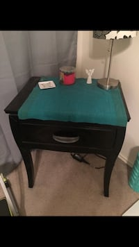 black nior furniture set. Come with dresser and mirror  with two nightstand tables