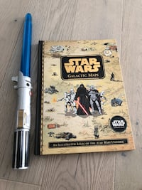 Star Wars book and lightsaber
