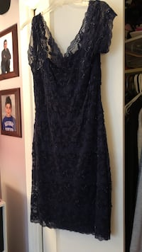 Blue/indigo lace sequence cocktail dress. Size 12 worn only once very comfortable. Flower prince with blue sequence all over dress. New Windsor, 12553