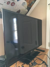Black flat screen tv with remote 40inch $90 is firm Roswell, 30076