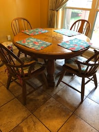round brown wooden table with four chairs dining set Haughton, 71037